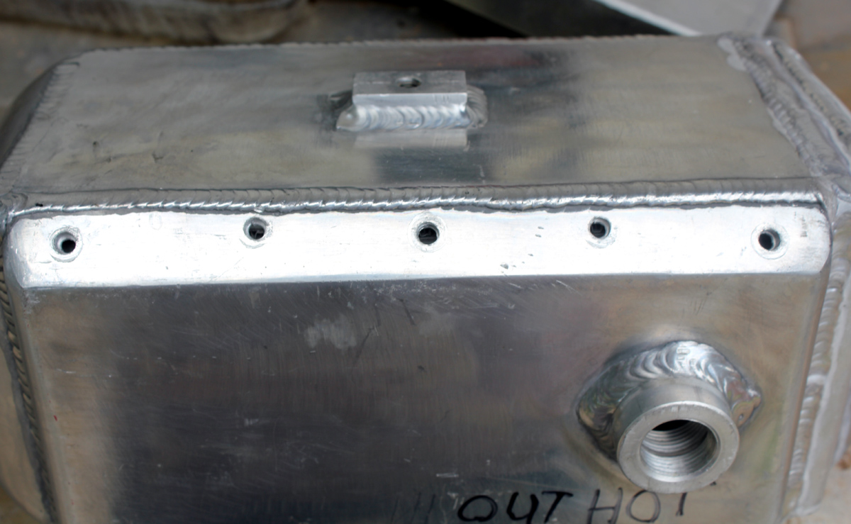 Hot side water tank intercooler